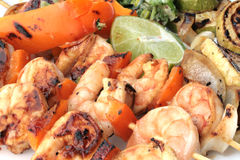Grilled prawns on bamboo sticks Stock Images