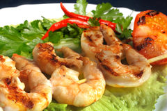 Grilled prawns on bamboo sticks Stock Photography