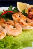 Grilled prawns on bamboo sticks Royalty Free Stock Photos
