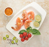 Grilled prawns with Basil and cherry tomatoes on a white plate Royalty Free Stock Photography