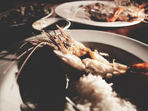 This is grilled prawns and cockle with rice on the white plate u Stock Photos