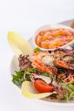 Grilled prawns with endive salad and jacket potato Stock Images