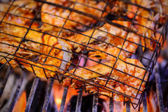 Grilled prawns on flaming Royalty Free Stock Photos