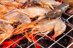Grilled prawns on flaming grill Stock Photo