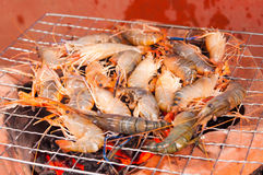 Grilled prawns on flaming grill. Stock Image