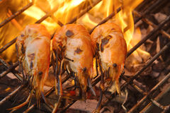Grilled prawns on flaming Royalty Free Stock Images