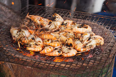 Grilled prawns. On the grill Royalty Free Stock Photo