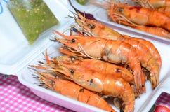 Grilled prawns. Neighboring Thailand market shops selling grilled shrimp Stock Photos