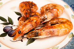 Grilled prawns on oplate Stock Photo