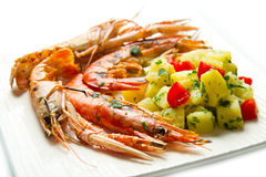 Grilled prawns with potatoes Royalty Free Stock Photo