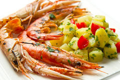 Grilled prawns with potatoes Stock Photo
