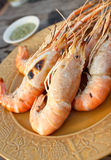 Grilled prawns. And seafood sauces royalty free stock images
