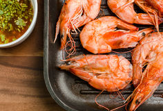 Grilled prawns served with spicy sauce Royalty Free Stock Images
