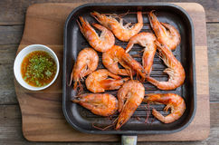 Grilled prawns served with spicy sauce Stock Images