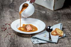 Grilled prawns with vegetable sauce on the plate with crispy bre Stock Photos