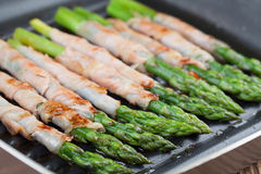 Grilled prosciutto wrapped asparagus Royalty Free Stock Images