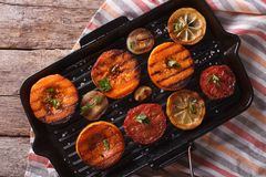 Grilled pumpkin on grill pan. Top view horizontal closeup Stock Photos