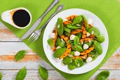 Grilled pumpkin, mini mozzarella, baby spinach and pumpkin seeds stock photo
