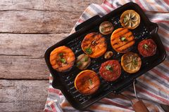 Grilled pumpkin and vegetables on grill pan. Top view horizontal Stock Photo