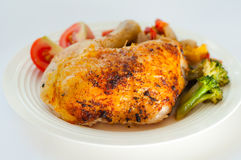 Grilled quarter chicken Stock Photography
