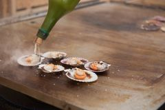 Queen scallops on the grill Royalty Free Stock Photo