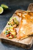 Grilled quesadillas tortillas with salsa, guacamole. Dark background Stock Image