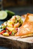 Grilled quesadillas & x28;tortillas& x29; with salsa, guacamole. Dark background Stock Image