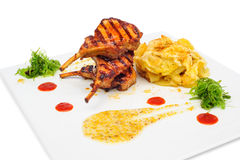 Grilled rabbit legs royalty free stock image