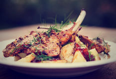 Grilled rack of lamb with fried potatoes and onion chutnee, tone Stock Images