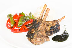 Grilled rack of of lamb with mint sauce Stock Photography