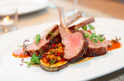 Grilled rack of lamb with vegetables royalty free stock image