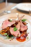 Grilled rack of lamb with vegetables Royalty Free Stock Images