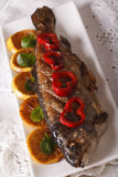 Grilled rainbow trout with vegetables close-up. vertical top vie Royalty Free Stock Photos