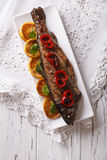 Grilled rainbow trout with vegetables. vertical top view Stock Photo