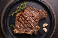Grilled rare rib steak. Top view of grilled rare rib steak Stock Photos