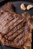 Grilled rare rib steak. Top view of grilled rare rib steak Stock Image