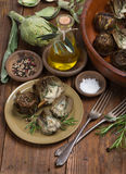 Grilled and raw artichokes Stock Photography