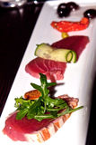 Grilled and raw tuna-fish on white plate