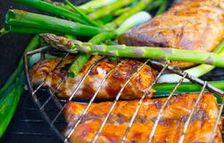 Grilled and Ready. Tasty pork and vegetables on a coal grill Stock Photography