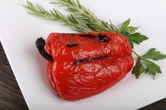 Grilled red bell Pepper. With rosemary and parsley stock image