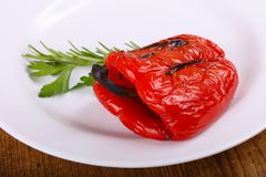 Grilled red bell Pepper. With rosemary and parsley royalty free stock photography