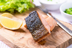Grilled red fish fillet with lemon and green salad Royalty Free Stock Photography