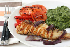 Grilled red-fish with spinach Royalty Free Stock Image