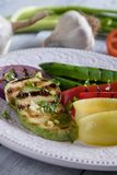 Grilled red, green and yellow peppers Royalty Free Stock Photography