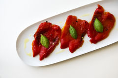 Grilled red peppers. In a white tray Royalty Free Stock Photography