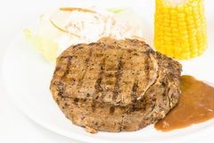 Grilled rib eye steak, corn on the cob and salad Stock Photography
