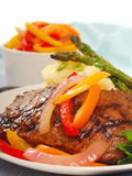 Grilled rib-eye steak with mashed potatoes Royalty Free Stock Images