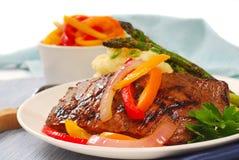 Grilled rib-eye steak with mashed potatoes Stock Photo