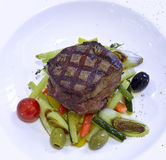 Grilled rib-eye steak with ratatouille Stock Image