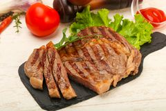 Rib eye steak. Grilled Rib eye steak with sauce Royalty Free Stock Photo